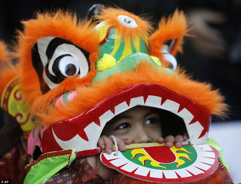 This youngster was spotted peering out from underneath his dragon costume, which had a red and yellow tongue of fire poking from the mouth